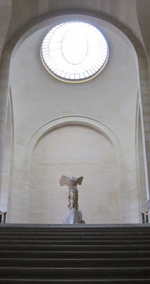 Winged Victory of Samothrace in an empty hall on a private guided Louvre tour in Paris