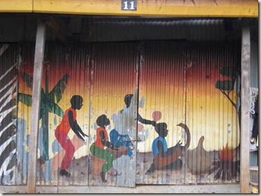 mural painted on the gates of a Kampala curio (soveneir) shop