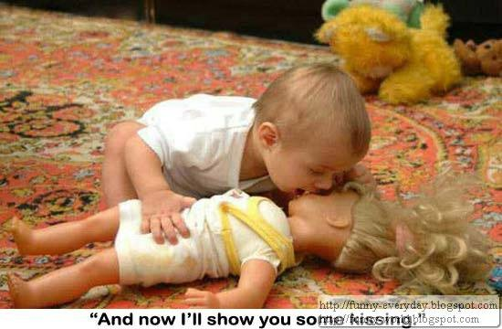 funny-baby-pictures-kissing-a-doll1