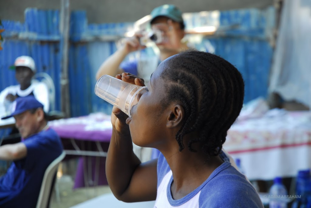A Haitian woman drinks MMS in Port-au-Prince medical mission.