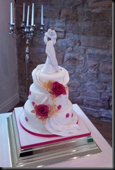 2-tier-drape-rose-and-figure-cake
