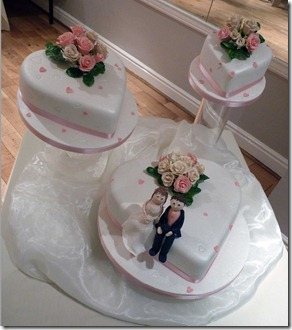 3-tier-tilting-cakes-with-rose-and-modeled-characters