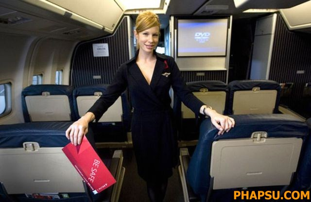 "** FOR RELEASE SUNDAY, MARCH 23, AND THEREAFTER ** Delta Airlines flight attendant Katherine Lee is  pictured on board a Delta jet Monday March 10, 2008, in Atlanta. Lee appears in the airline's new safety video and has been dubbed ""Deltalina"" by some on YouTube, in reference to her likeness to Angelina Jolie, where the video has been posted. (AP Photo/John Amis)"