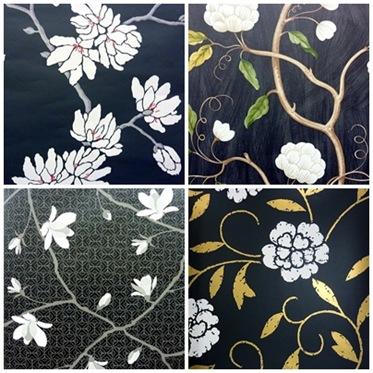 Vita blommor på svart botten