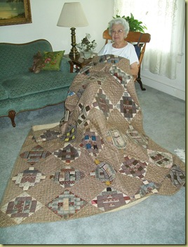 Aunt Maggie Barns with her daddy's quilt