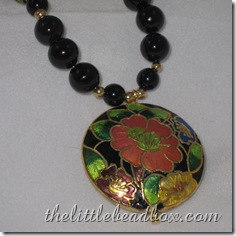 China Girl - black onyx necklace with black cloisonne beads and pendant with gold plated toggle clasp and spacer beads. £18.00