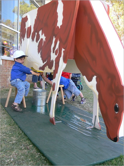j milks cow