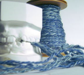 blue yarn with teeth