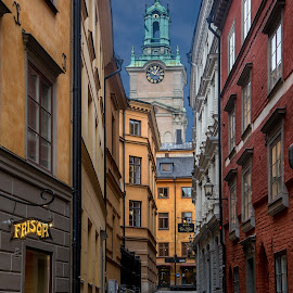 Down an Alley by Matt Shell - City,  Street & Park  Neighborhoods ( sweden, stockholm, clock, shops, alley )