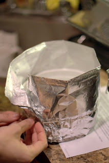 picture of foil being wrapped around souffle dish and fastened to make a collar