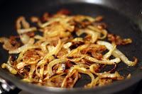 picture of fully browned onions in saute pan