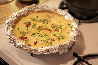 picture of quiche crust covered with foil