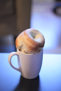 picture of popover in white coffee cup