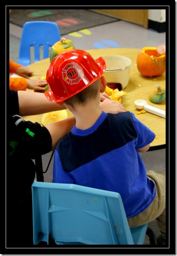 carving a pumpkin at preschool