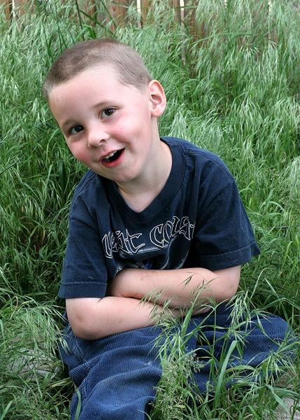 Caleb in the grass 2