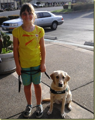 My little future guide dog puppy raiser with Reyna.  Sara has a big smile on her face.