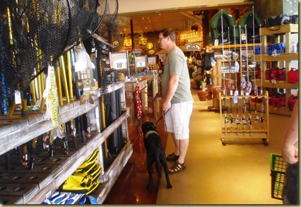 Tony and Sheba shopping at the Bass Pro Shop in the fishing department.
