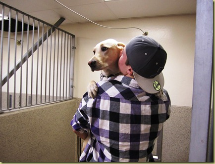 Reyna is in Tyler's arms and he his kissing her cheek as they say good bye in the kennel.