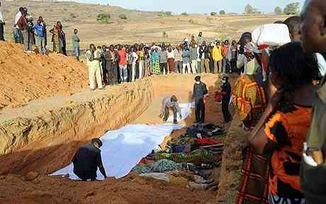 Nigerians accumulate at a mass funeral of their kinsmen killed during a eremite predicament in the encampment of Dogo Nahawa south of Jos.