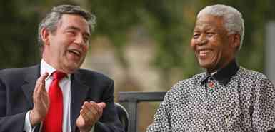 British Prime Minister Gordon Brown applauds former South African President Nelson Mandela