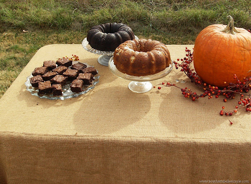 A burlap table cloth pumpkins and other natural elements really created the