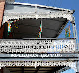 The balcony and wrought iron work of the Maldon Hotel