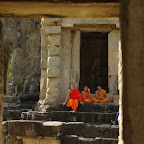 These young monks are sitting on the steps to the east entry door. However, the devata (sacred women) are in the chamber on the west side of the temple.