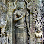 Thommanon Devata (sacred female image). Note the pleated, wrapped sampot style, rolled to open like a flower at the top. These represent a style seen on older Khmer temples. Also note that the women with the pleated skirts are represented at higher elevations at Thommanon, suggesting that these ancestors are perhaps being honored above the (contemporary) devata who appear in Angkor Wat style sampots below. Siem Reap, Cambodia http://www.Devata.org