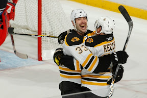 Zdeno Chara and Mark Recchi celebrate Recchi's 2nd goal of the game, his 1,500 career NHL point