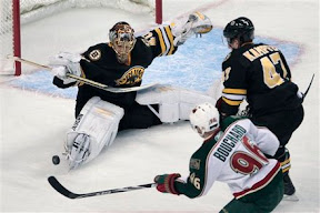 Tuukka Rask makes a save