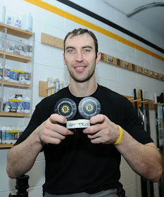 Zdeno Chara after the game celebrating his first NHL career hat trick