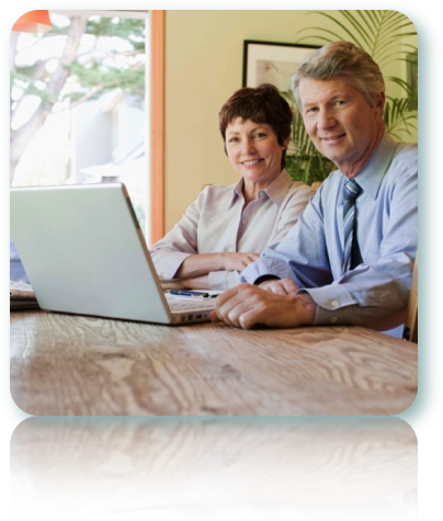 Smiling couple starting a personal loan application online.