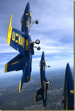 The Blue Angels Diamond Formation performs a dirty loop over Naval Air Station Pensacola, Fla. U.S. Navy Photo by Photographer's Mate 2nd Class (AW/NAC) Ryan Courtade. (RELEASED)
