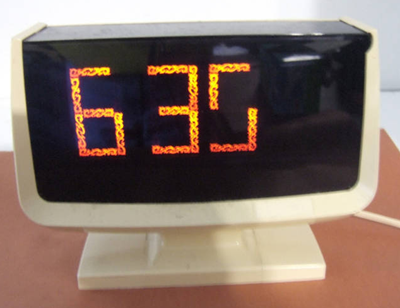 Lumitime clock, orange script bar readout