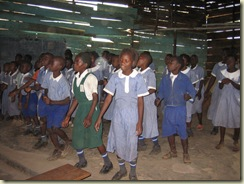 Children singing at Kiswa School. Kampala