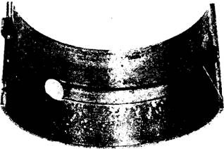Foreign particles embedded in a bearing.