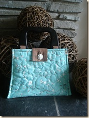 good turquoise bag up close