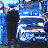 BYE377H - A rather hazy still from a film apparently taken at the start of the rally. This shows Bobby Buchanan-Michaelson getting a speeding ticket just after fixing a problem with the car. Legend has it that the adjustable metering unit was set for the wrong height.