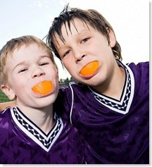 2boys-with-orange-wedges