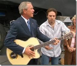 George Bush playing guitar while...