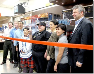 IQALUIT: DECEMBER 3, 2010 -- IQALUIT TIMMIE'S -- Inukshuk and Michael use a traditional ulu knife to cut the ribbon and open the Iqaluit Timmie's locations while flanked by Tim Hortons and North West Company management, associated charity heads and other dignitaries.
