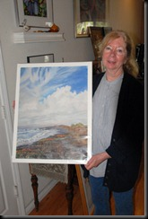 Susan Goodmundson with one of her paintings.