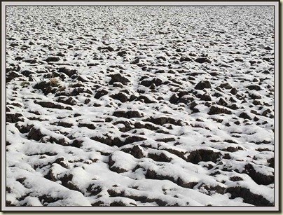 Ploughed field on a snowy morning