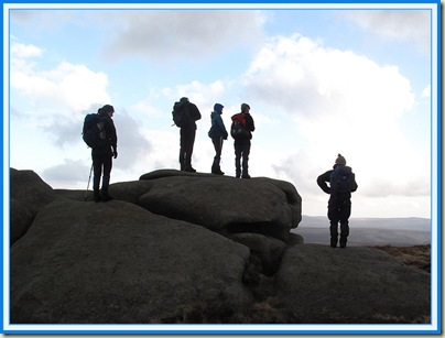 Ramblers admiring the view from Bleaklow Stones, Dark Peak, Derbyshire, UK