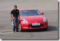 Narain Karthikeyan with the Nissan 370Z at the launch 20 Jan 2010 Red Nissan 370Z India Automotic Manual Images Pictures Pics Wallpapers Gallery Video Specifications Reviews
