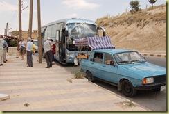 Van in front of coach