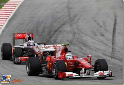 Fernando Alonso (ESP) Ferrari F10 leads Jenson Button (GBR) McLaren MP4/25. Formula One World Championship, Rd 3, Malaysian Grand Prix, Race, Sepang, Malaysia, Sunday 4 April 2010.