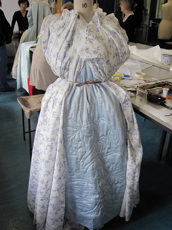 Top fabric draped over the quilted petticoat