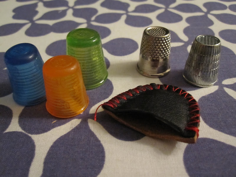 My thimbles: 3 x rubber, 2 x metal, and a leather thimble.