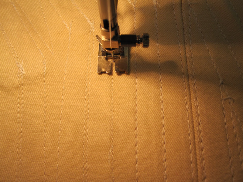 Topstitching following the boning stitch lines on the base layer.